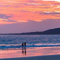 Couple on Beautiful Galapagos beach at sunset