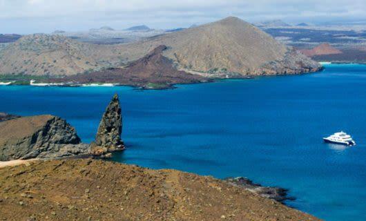 Galapagos cruise ship passes Pinnacle Rock