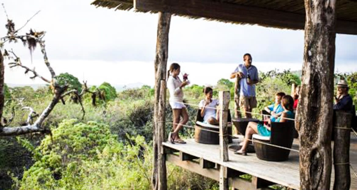 Group of people sits on Galapagos porch