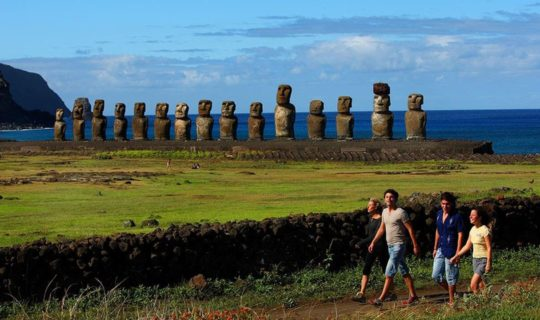 freinds-walking-past-heads-of-easter-island