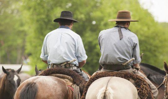 two-argentinian-men-on-horseback