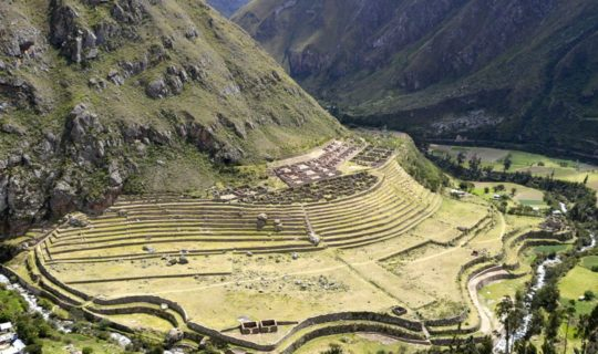 distant-shot-of-ruins-hugging-mountain-side-on-inca-trail