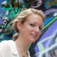 portrait of Katherine standing near a mural