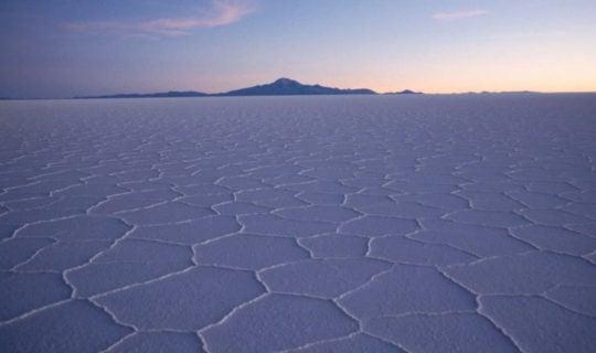 dry-uyuni-salt-flats-at-sunset-with-purple-shades
