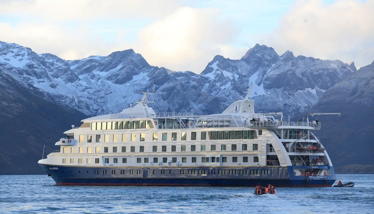 patagonia-cruise-ship-anchored-in-front-of-iceberg