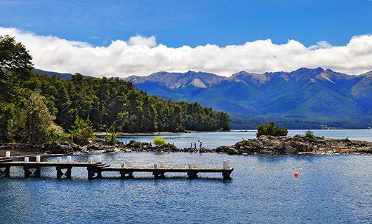 serene-dock-extending-over-lake-in-bariloche