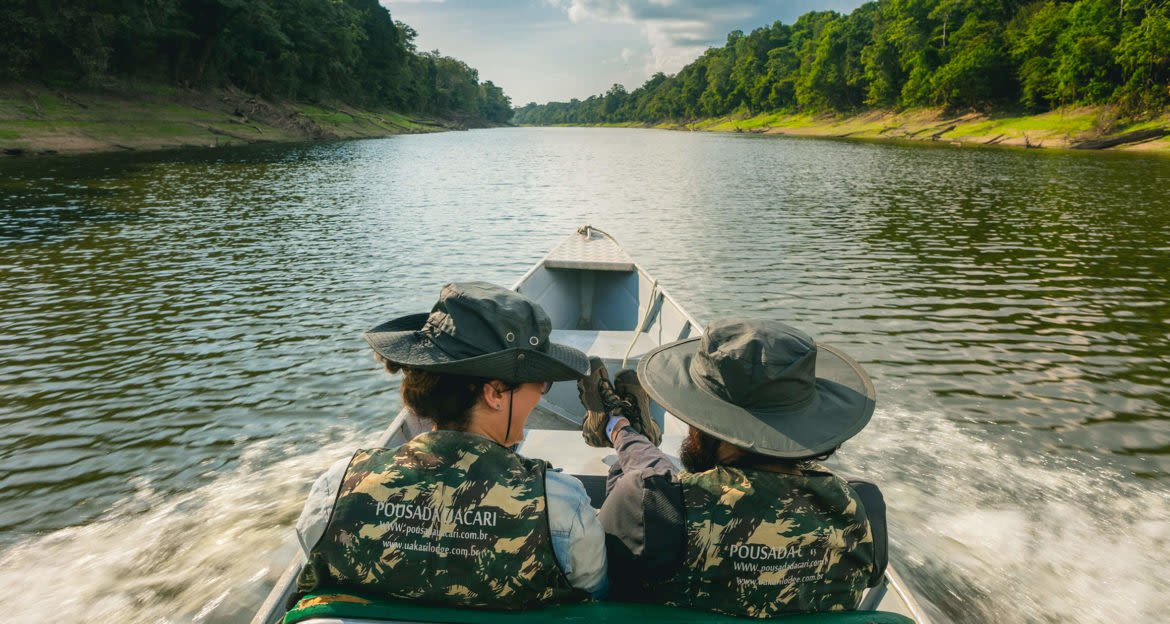 two people on a boating excursion at the uakari lodge