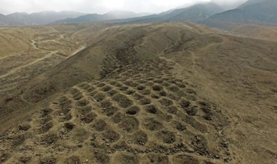 band-of-holes-in-peru-mysterious-sand-hill-with-hundreds-of-digged-holes