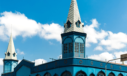 very-blue-church-in-belem-with-several-small-towers