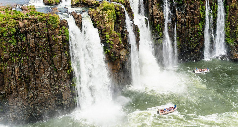 people-in-boat-approaching-iguazu-falls