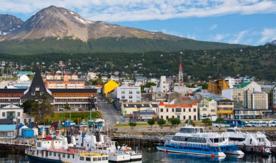 ushuaia-bay-with-boats-docked-and-the-town-behind