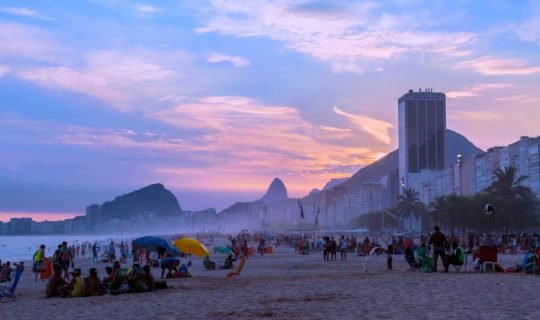 busy-copacabana-beach-at-sunset