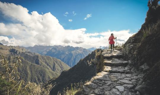 lady-hiking-near-steep-cliff-on-inca-trail