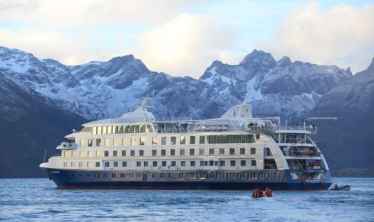 grand-australis-cruise-on-beautiful-bay-with-mountains-in-back