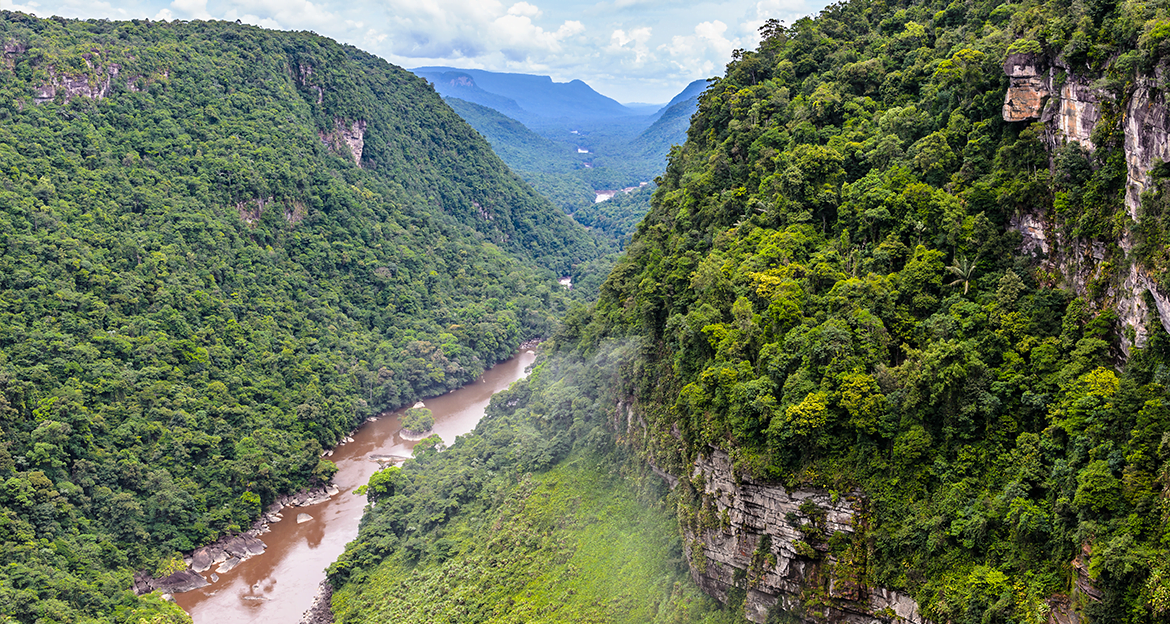 view-from-mountain-over-jungle-river-valley