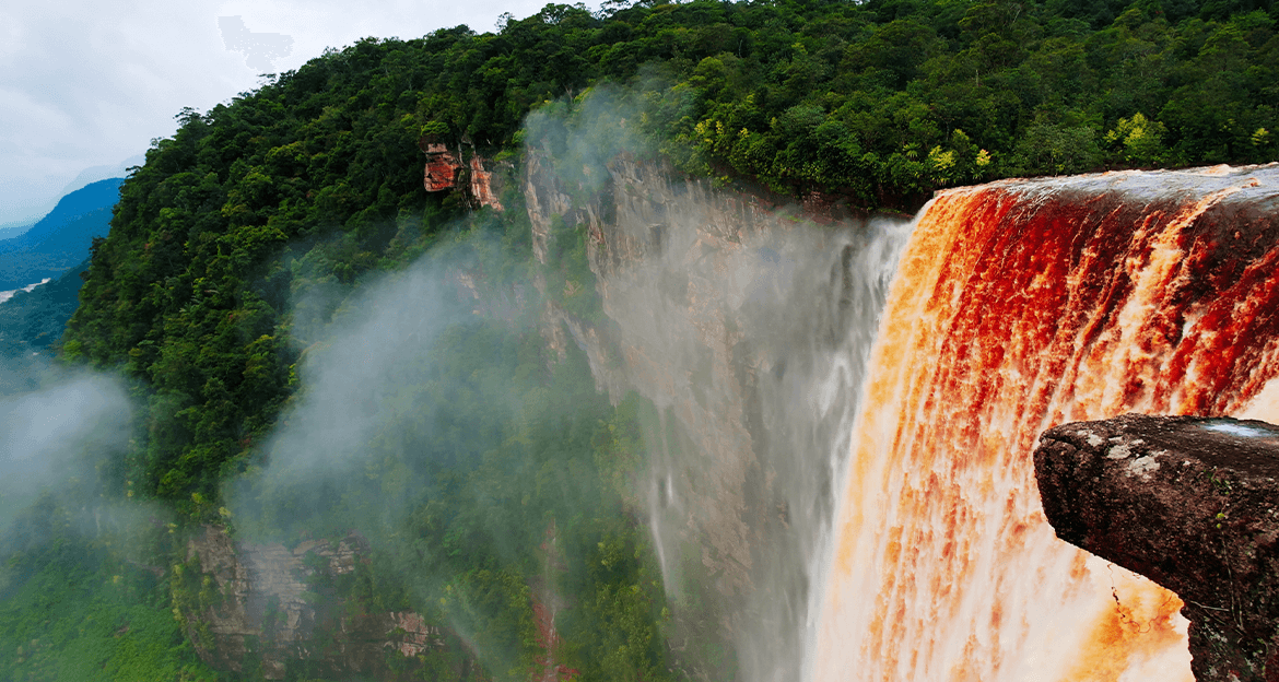 kaieteur Waterfall on foggy morning, with red waters during Wild Guyana Tour