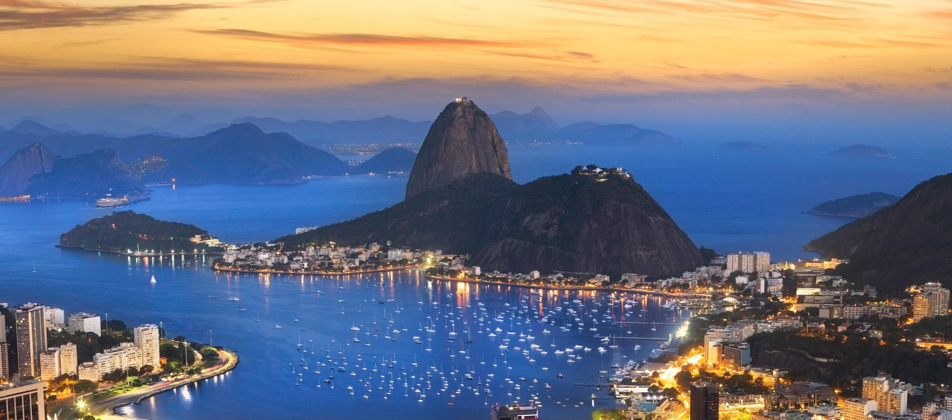If you are thinking of a trip to South America - Travel to South America and see this incredible view of Sugar Loaf Mountain. This is at night view of Rio de Janeiro in Brazil.