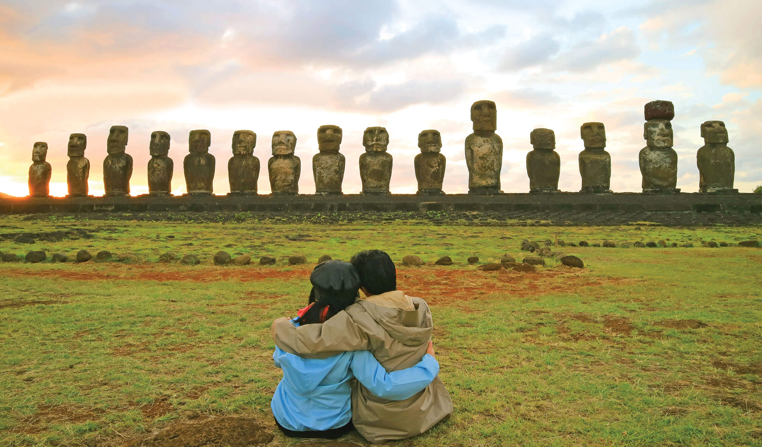 couple looking at the moais in easter island chile