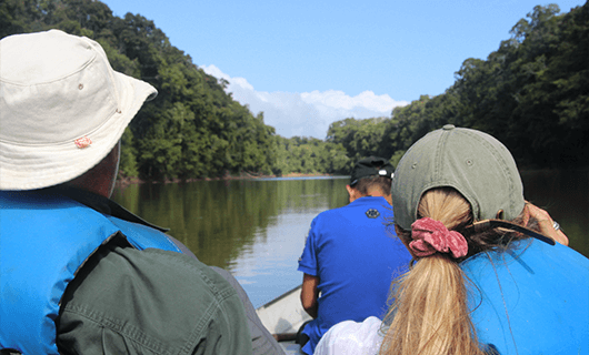 family on river boat and jungle tour in Guyana
