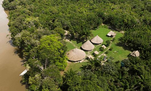 beautiful aerial view over riverside thatch resort in Guyana