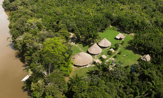 beautiful aerial view over riverside thatch resort in Guyana
