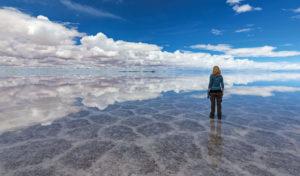 Woman standing on the Uyuni Salt Flats in Bolivia