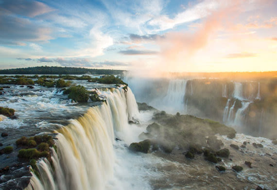 Aerial view of rushing waterfalls of Iguazu Falls