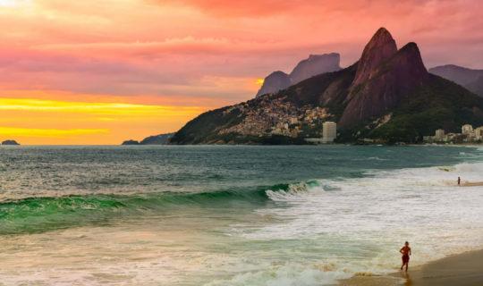 Man running on beach during sunset on Rio de Janeiro tour