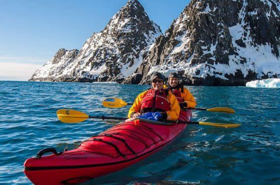 Travelers Kayaking around Antartica sites