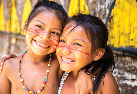 Faces of two girls in a local Amazonian community
