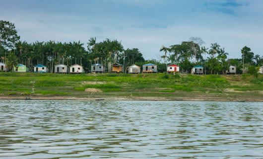 Distant shot of local Amazonian community with stilt houses