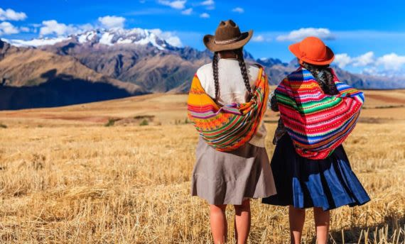 local women looking at view of sacred valley
