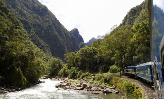 Perurail train passing river