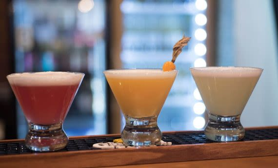three traditional pisco sours on table