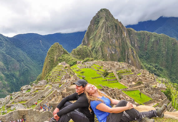 couple at the top of machu picchu mountain