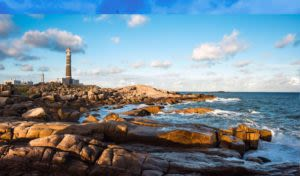 rocky beach and lighthouse uruguay