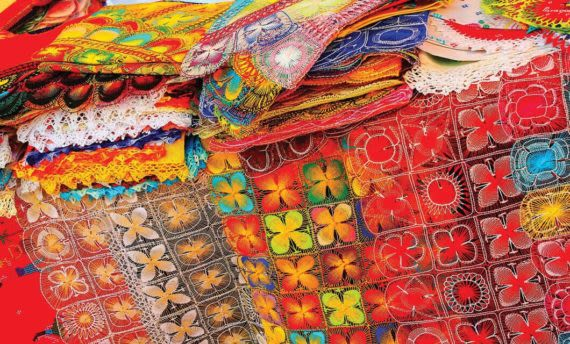colorful textiles at market in Paraguay