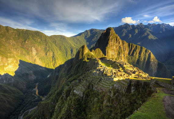the sunrise over machu picchu mountain