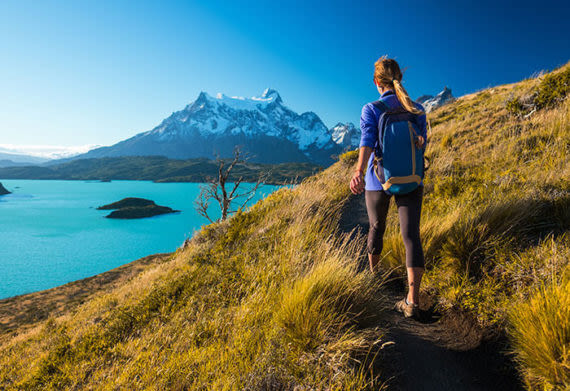 woman hiking in torres del paine chile patagonia