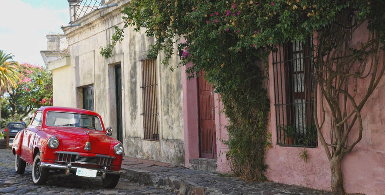old vintage car on historic road in Colonia