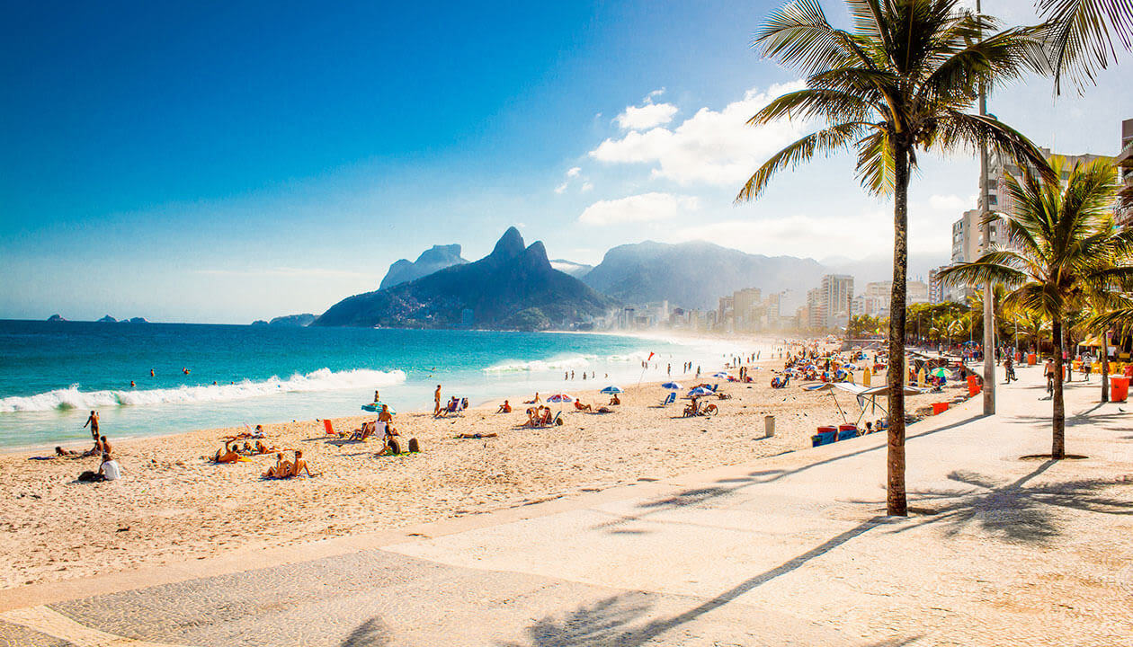 ipanema beach with beach goers and palm trees