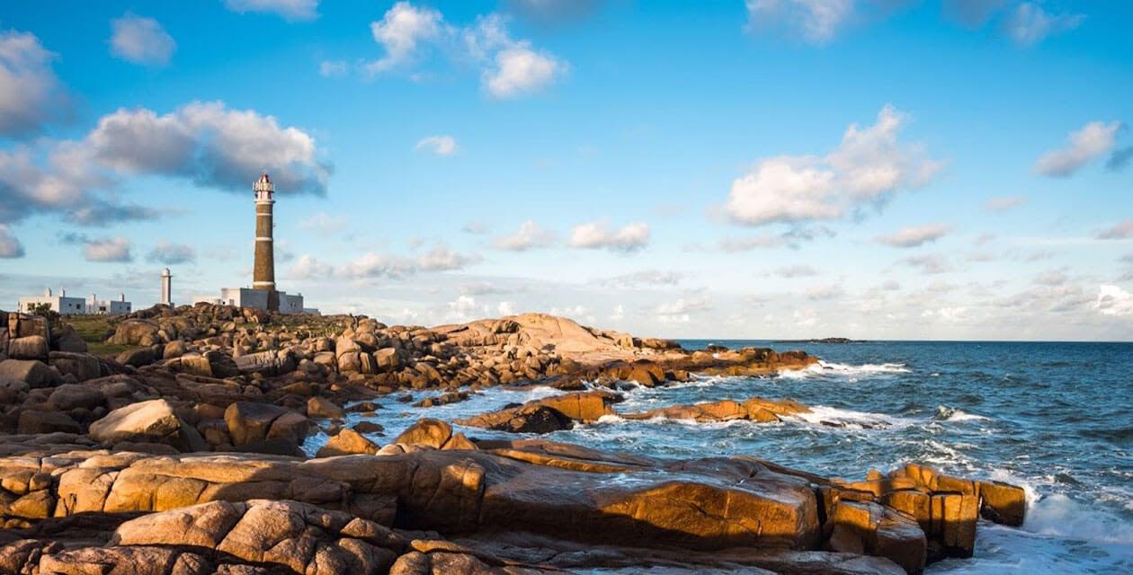 scenic lighthouse along rocky shore