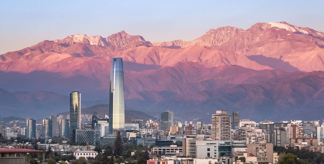 Santiago cite center with Andes mountains at sunset