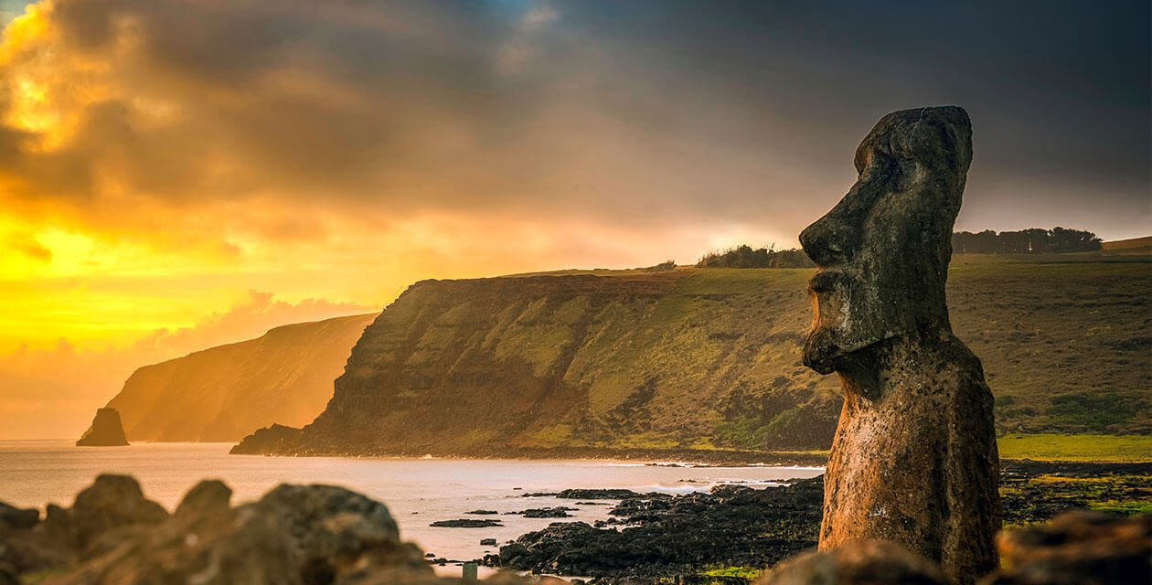 Moai statue of Easter Island with sunset back