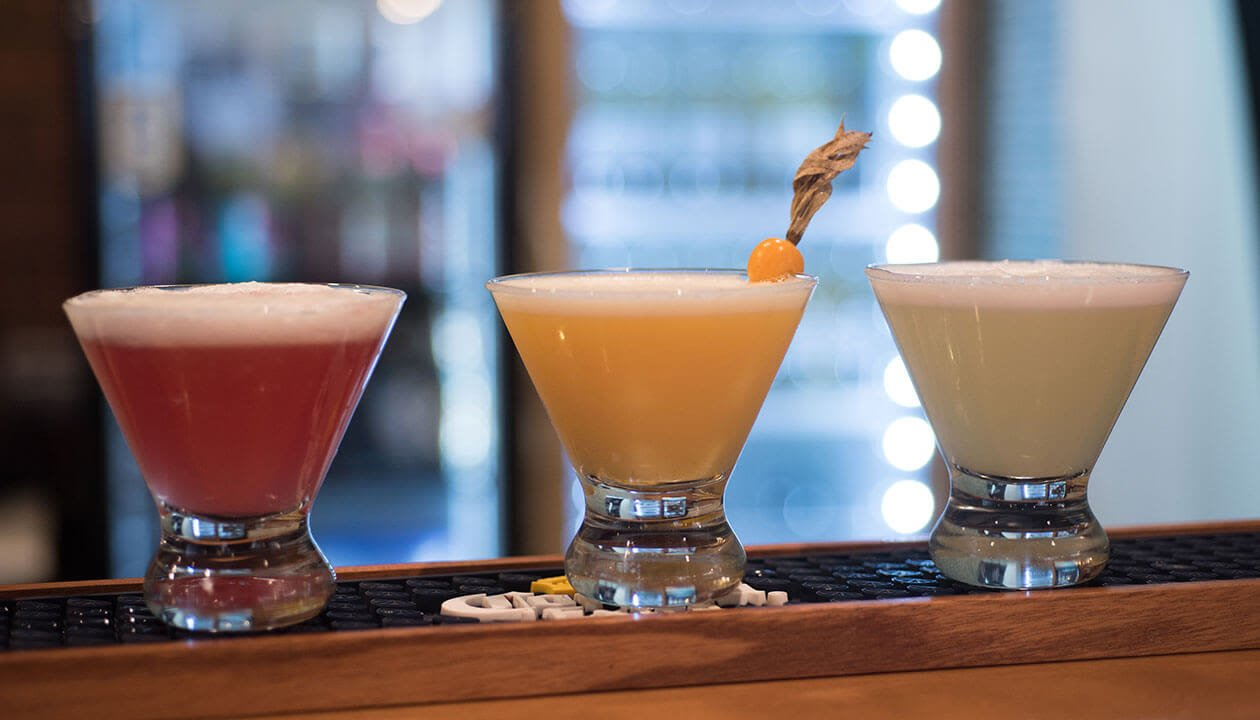 three different flavors of pisco sour cocktail