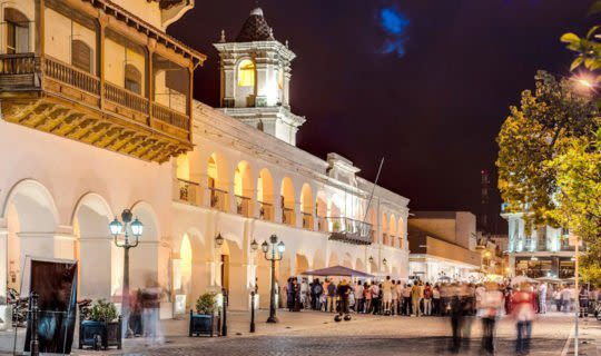 people walking around salta, a town in argentina