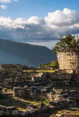 sun shining down on the kuelap ruins in peru