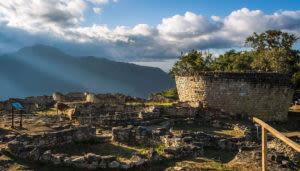 sun shining down on the kuelap ruins in peru