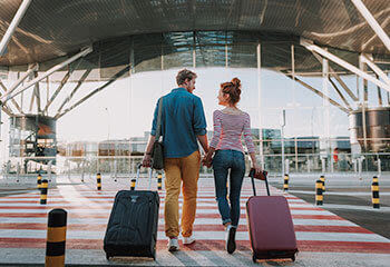 Couple walking to the airport