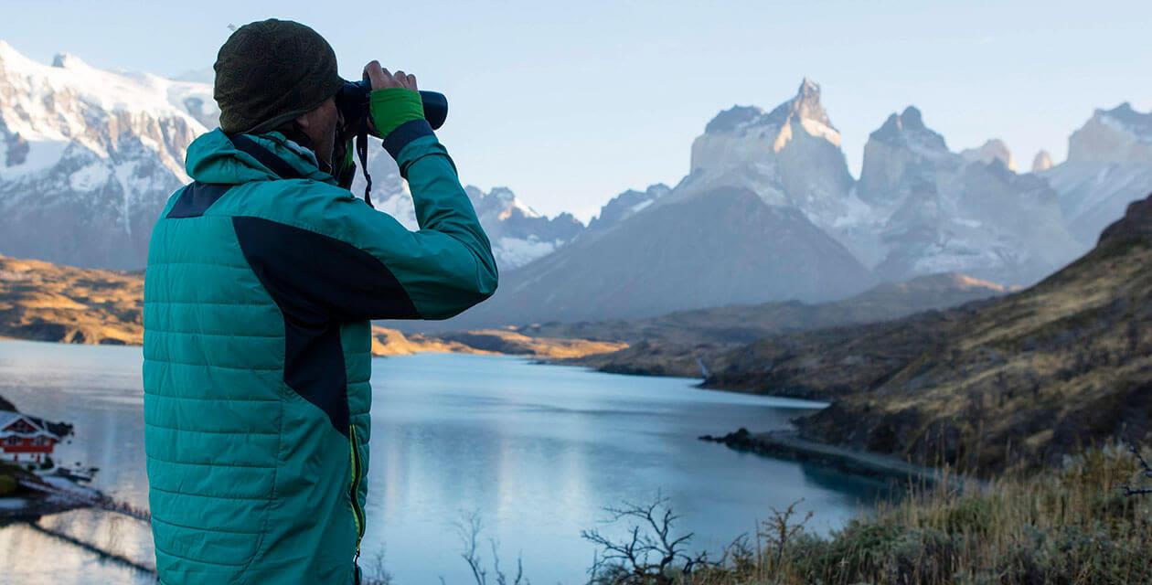 man looking out binoculars